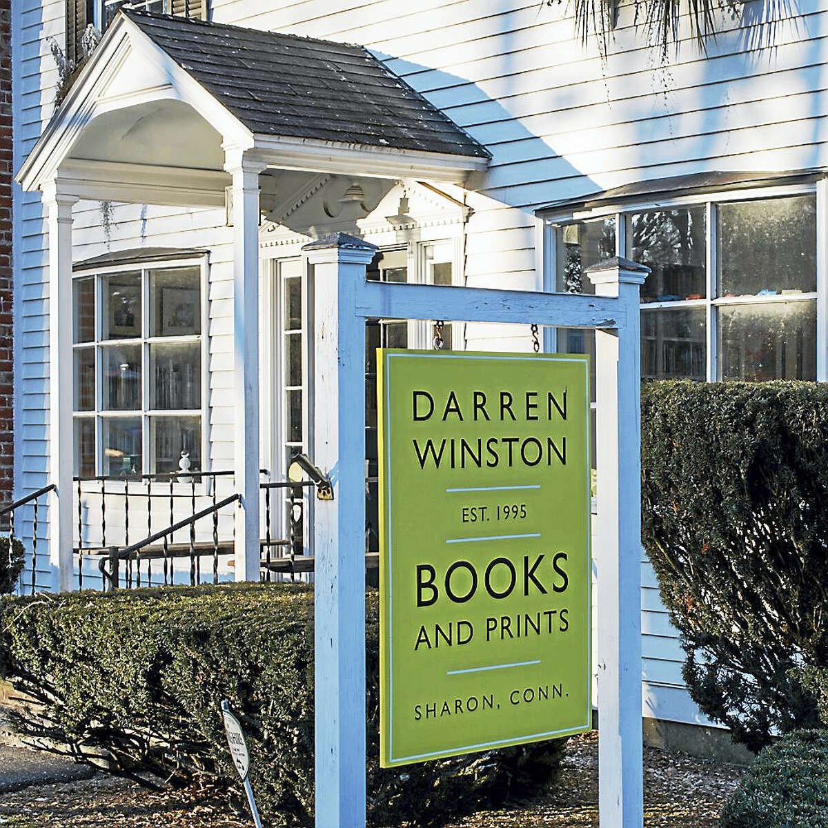 Photo by Debra Bilow A sign outside the book and print shop in Sharon.