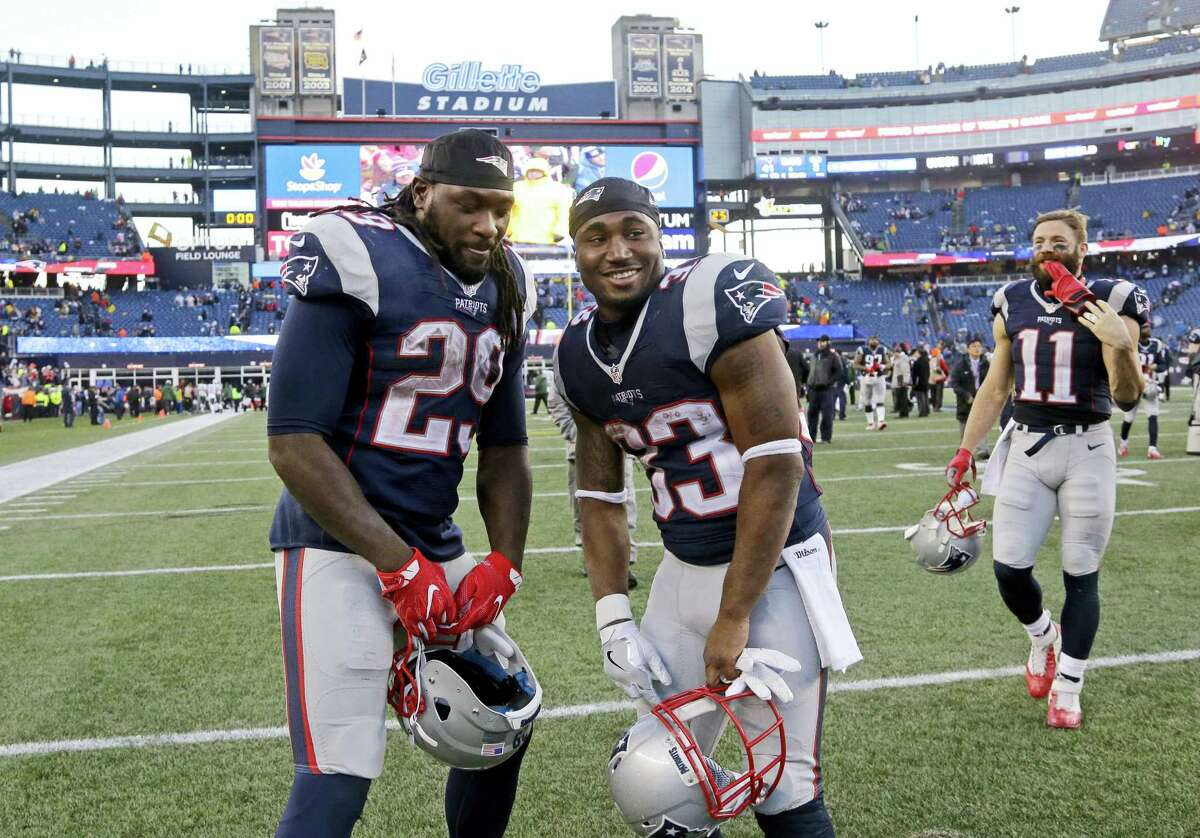 Patriots running backs LeGarrette Blount (29) and Dion Lewis (33) pose after last week's win over the Jets in Foxborough, Mass.