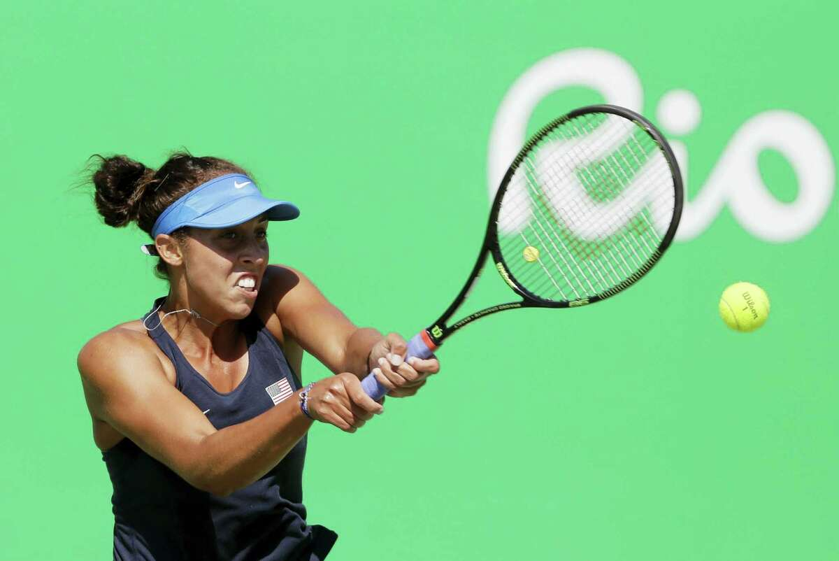 In this Aug. 13, 2016 photo, Madison Keys of the United States hits a return to Petra Kvitova, of the Czech Republic, during their women's singles bronze-medal tennis match at the Summer Olympics in Rio de Janeiro, Brazil.