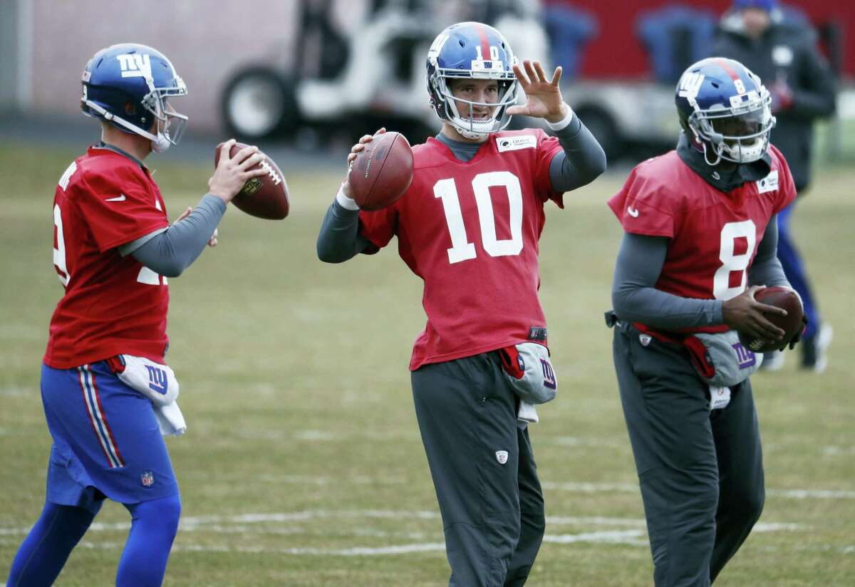 Giants quarterbacks, from left, Keith Wenning, Eli Manning and Josh Johnson.