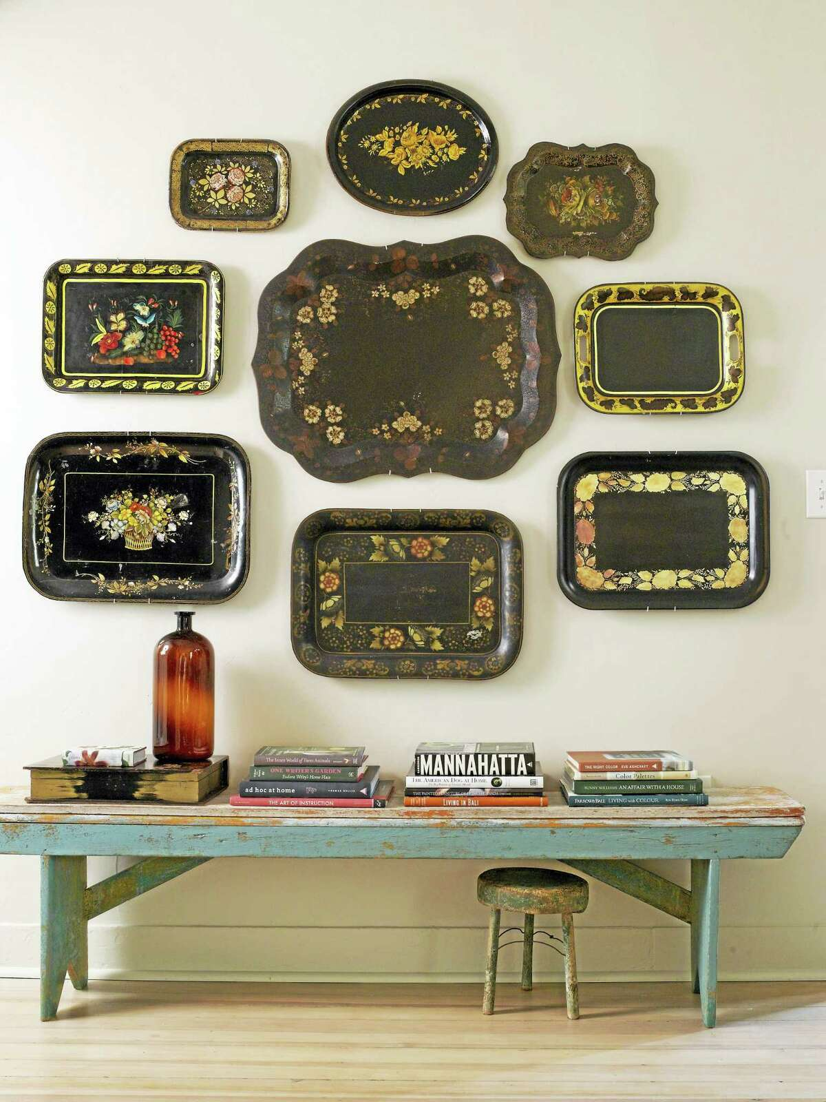 Photo courtesy Rizzoli USAGroupings of accessories can be hung in artistic clusters to bring detail and character to a lonely wall. Here, variations on a black tray feel as much like an installation as a treasured collection. Designer: Joan Osofsky.
