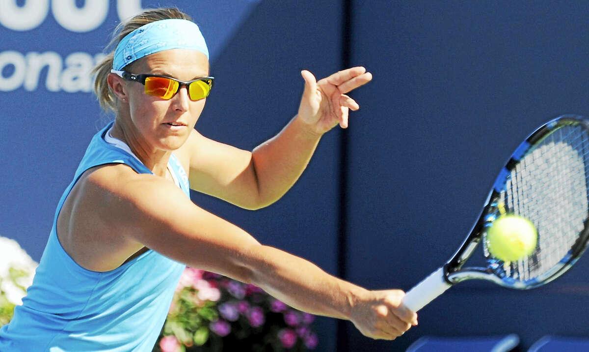 Kirsten Flipkens hits a backhand return at the Connecticut Open on Wednesday.