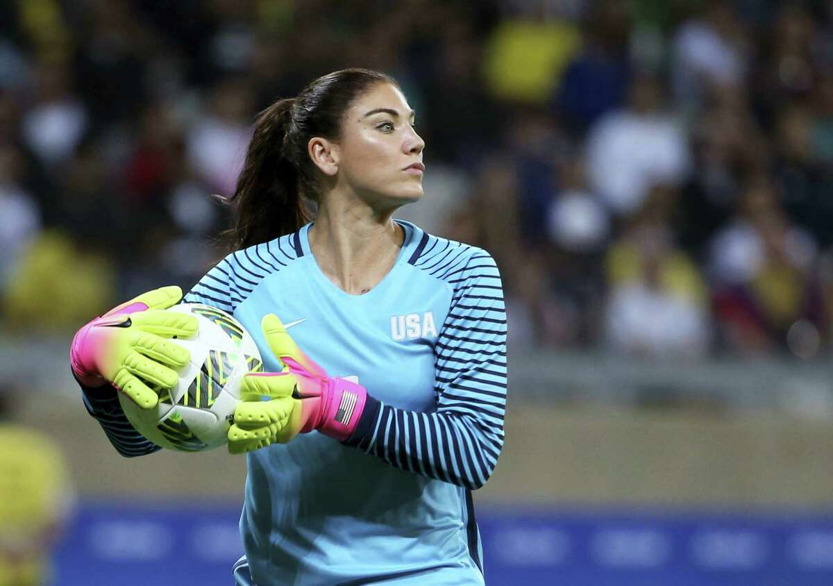 """In this Aug. 3 file photo, U.S. goalkeeper Hope Solo takes the ball during a women's Olympic soccer tournament match against New Zealand. Solo has been suspended form the team for six months for what U.S. Soccer termed conduct """"counter to the organization's principles."""" The suspension is effective immediately."""
