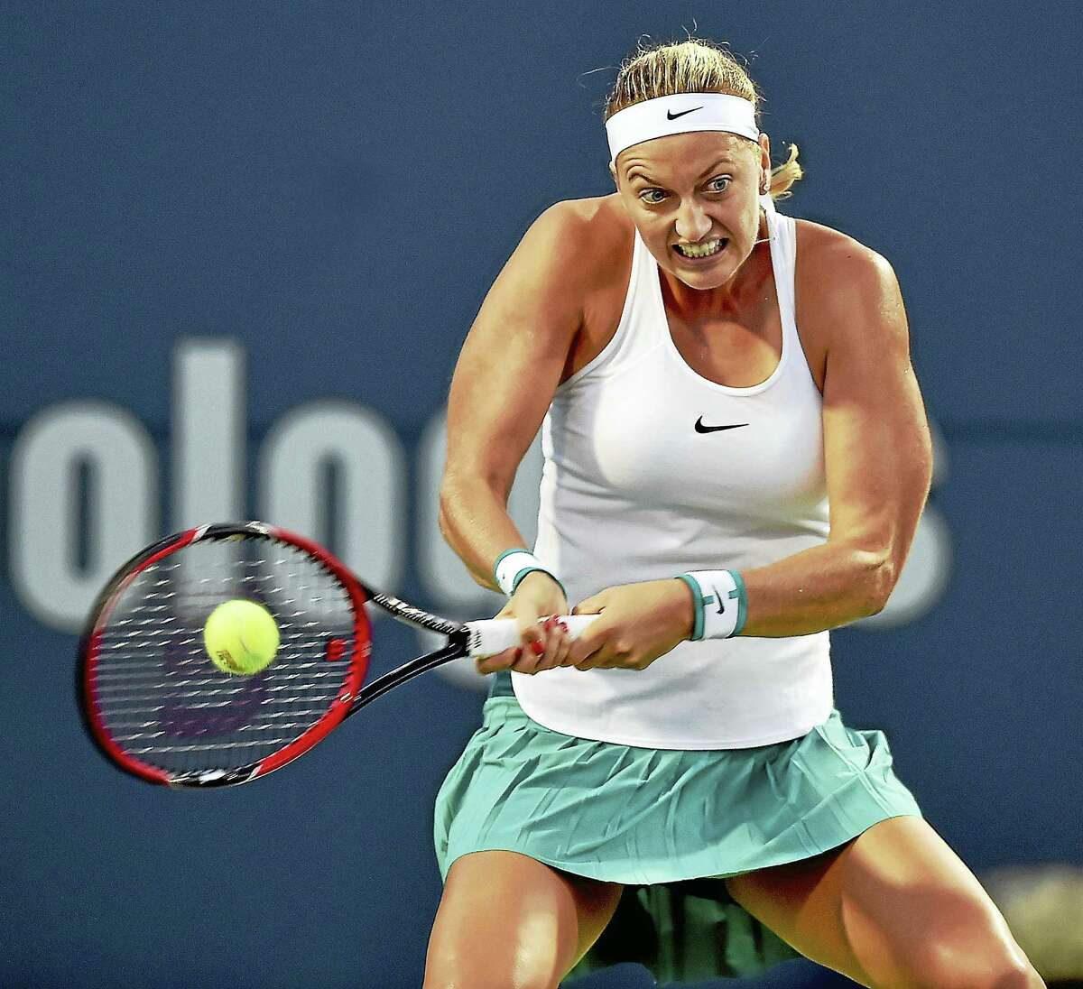 Czech Petra Kvitova hits a forehand return to Canadian Eugenie Bouchard in a 6-3, 6-2 win Wednesday evening in the second round of the Connecticut Open in New Haven.
