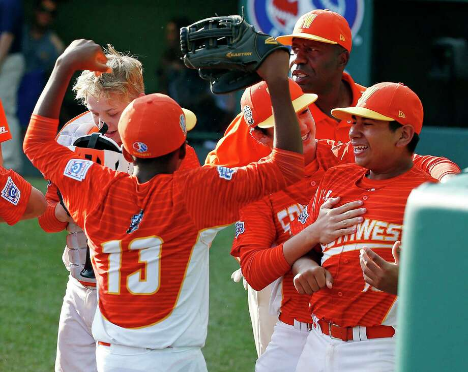 Texas' Mark Requena, right, celebrates with teammates after getting the final out of a 6-5 win over North Carolina in the United States Championship baseball game at the Little League World Series tournament in South Williamsport, Pa., Saturday, Aug. 26, 2017. (AP Photo/Gene J. Puskar) Photo: Gene J. Puskar, STF / Copyright 2017 The Associated Press. All rights reserved.
