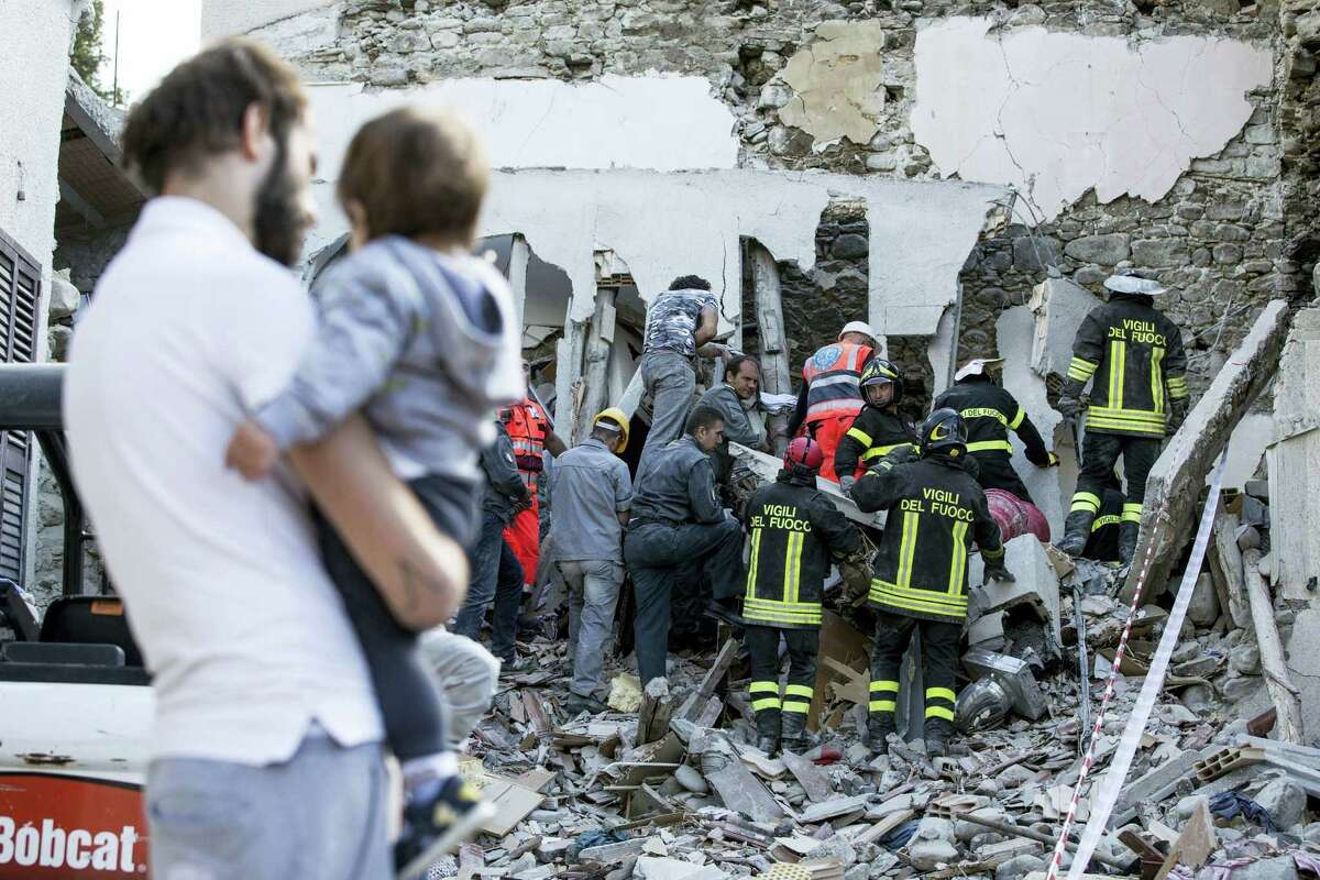Firefighters search amid rubble following an earthquake in Accumoli, central Italy, Wednesday, Aug. 24, 2016. A strong earthquake in central Italy reduced three towns to rubble as people slept early Wednesday, with reports that as many as 50 people were killed and hundreds injured as rescue crews raced to dig out survivors.