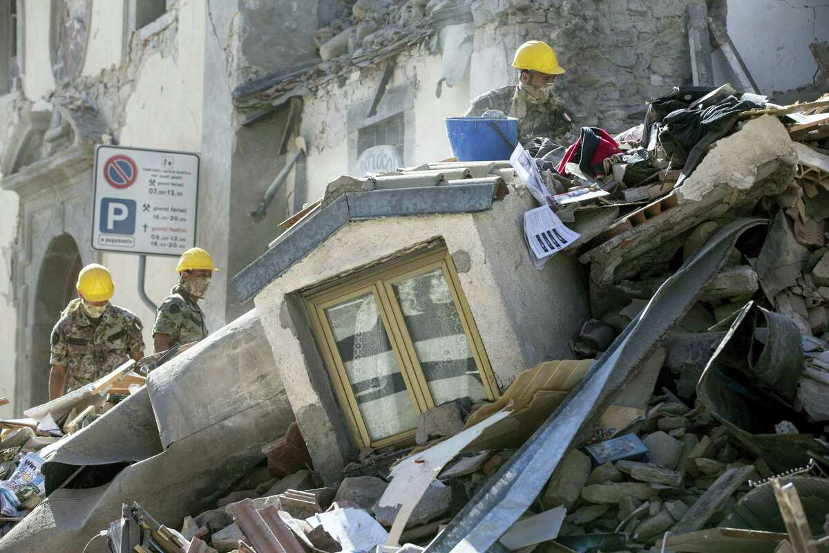 Soldiers search amid rubble of a collapsed house following an earthquake in Amatrice, central Italy, Wednesday, Aug. 24, 2016. A strong earthquake in central Italy reduced three towns to rubble as people slept early Wednesday, with reports that as many as 50 people were killed and hundreds injured as rescue crews raced to dig out survivors.