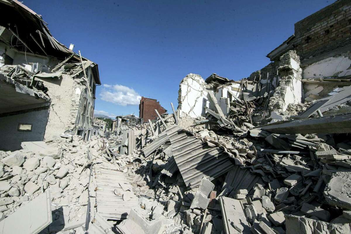A view of collapsed buildings and rubble following an earthquake in Amatrice, central Italy, Wednesday, Aug. 24, 2016. A strong earthquake in central Italy reduced three towns to rubble as people slept early Wednesday, with reports that as many as 50 people were killed and hundreds injured as rescue crews raced to dig out survivors.