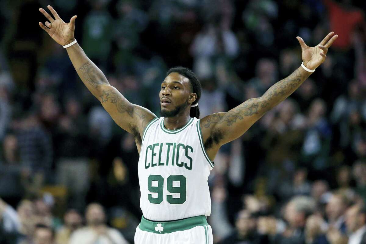 Boston Celtics' Jae Crowder reacts to a 3-pointer by teammate Avery Bradley during the fourth quarter of an NBA basketball game against the New Orleans Pelicans in Boston, Wednesday, April 6, 2016. The Celtics won 104-97. (AP Photo/Michael Dwyer)