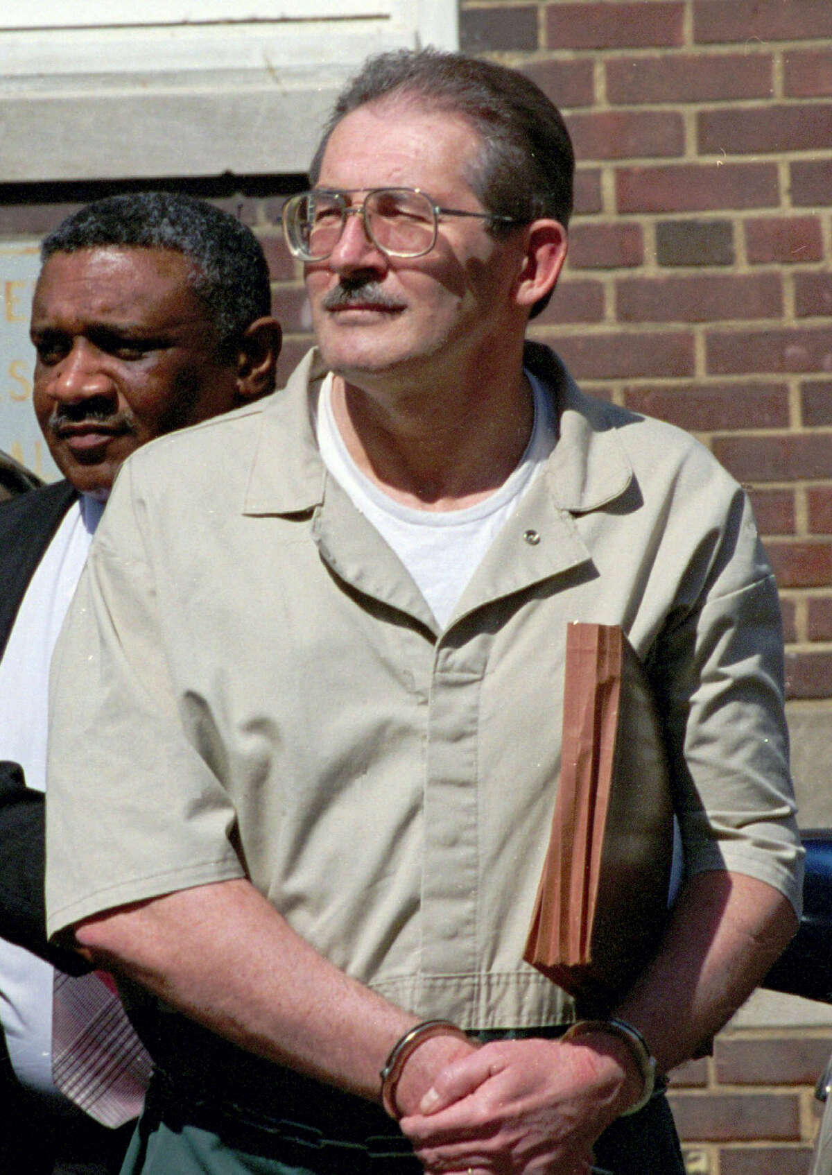 Former CIA agent Aldrich Ames leaves federal court in Alexandria, Va. in 1994. U.S. relations with Moscow during and after the Cold War have been marred by diplomatic dustups ranging from espionage scandals to an Olympics boycott.