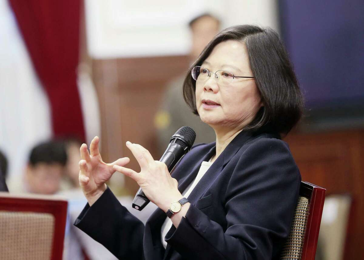 "In this photo released by the Taiwan Presidential Office, President Tsai Ing-wen delivers a year-end speech during an international press conference at the presidential office, Saturday, Dec. 31, 2016, in Taipei, Taiwan. President Tsai urged China to engage in ""calm and rational"" dialogue to maintain peace, vowing not to give in to Beijing's recent moves to ""threaten and intimidate"" the self-ruled island."
