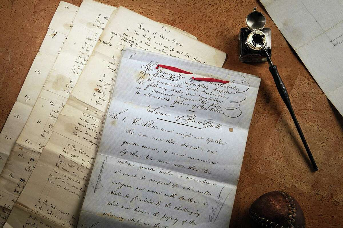 """This photo provided by SCP Auctions shows the 1857 documents titled """"Rules of Base Ball."""""""
