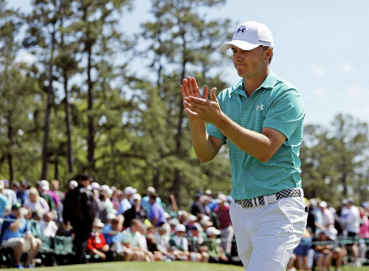 Jordan Spieth applauds on the 18th green following the first round of the Masters on Thursday.