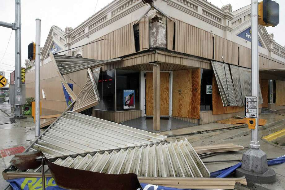 The Fair Department store in Cuero was damaged despite being boarded shut as Hurricane Harvey hits