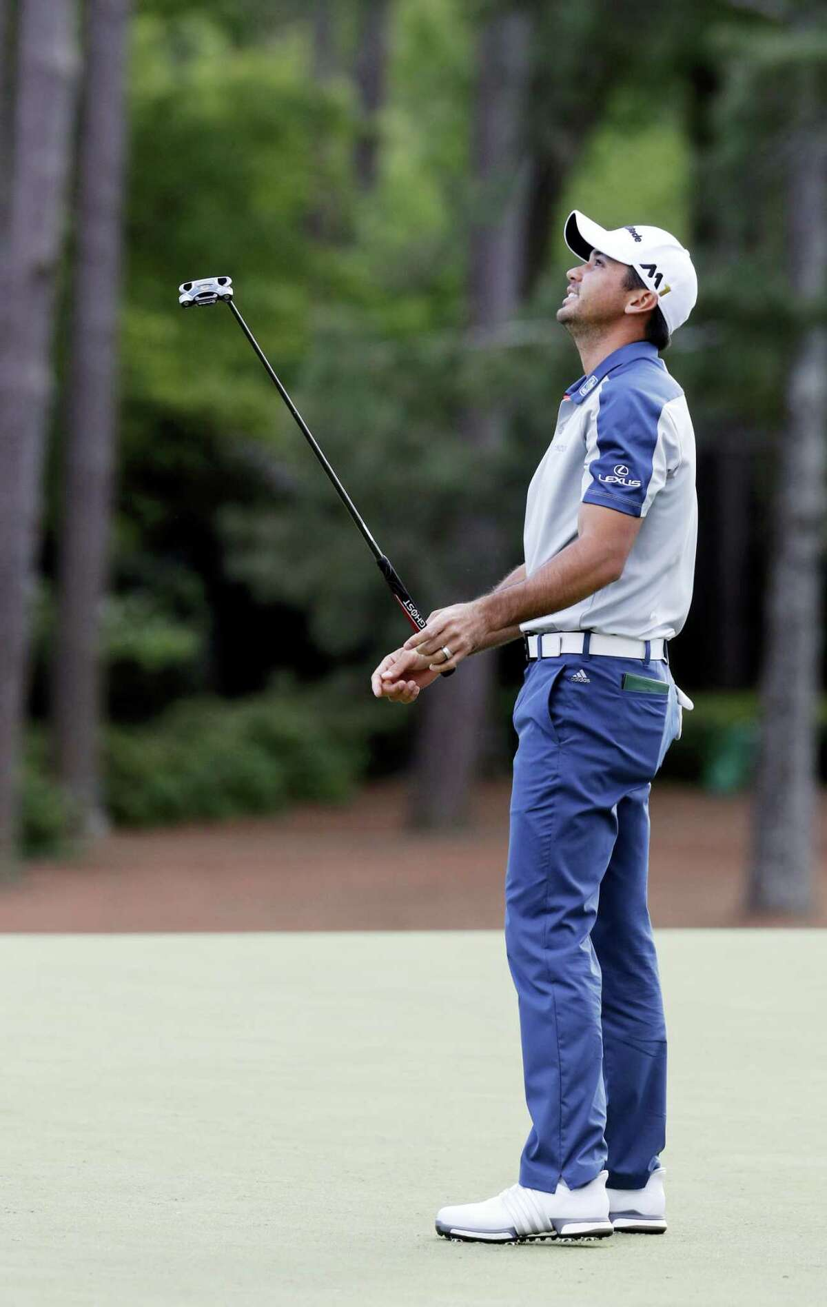 Jason Day reacts after missing a birdie putt on the 14th green on Thursday.