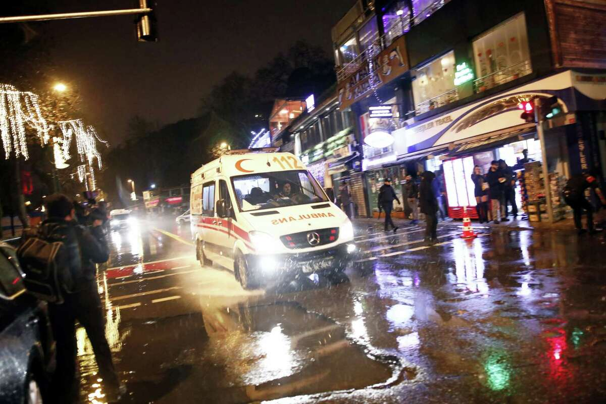 An ambulance rushes from the scene of an attack in Istanbul, early Sunday, Jan. 1, 2017. Turkey's state-run news agency said an armed assailant has opened fire at a nightclub in Istanbul during New Year's celebrations.