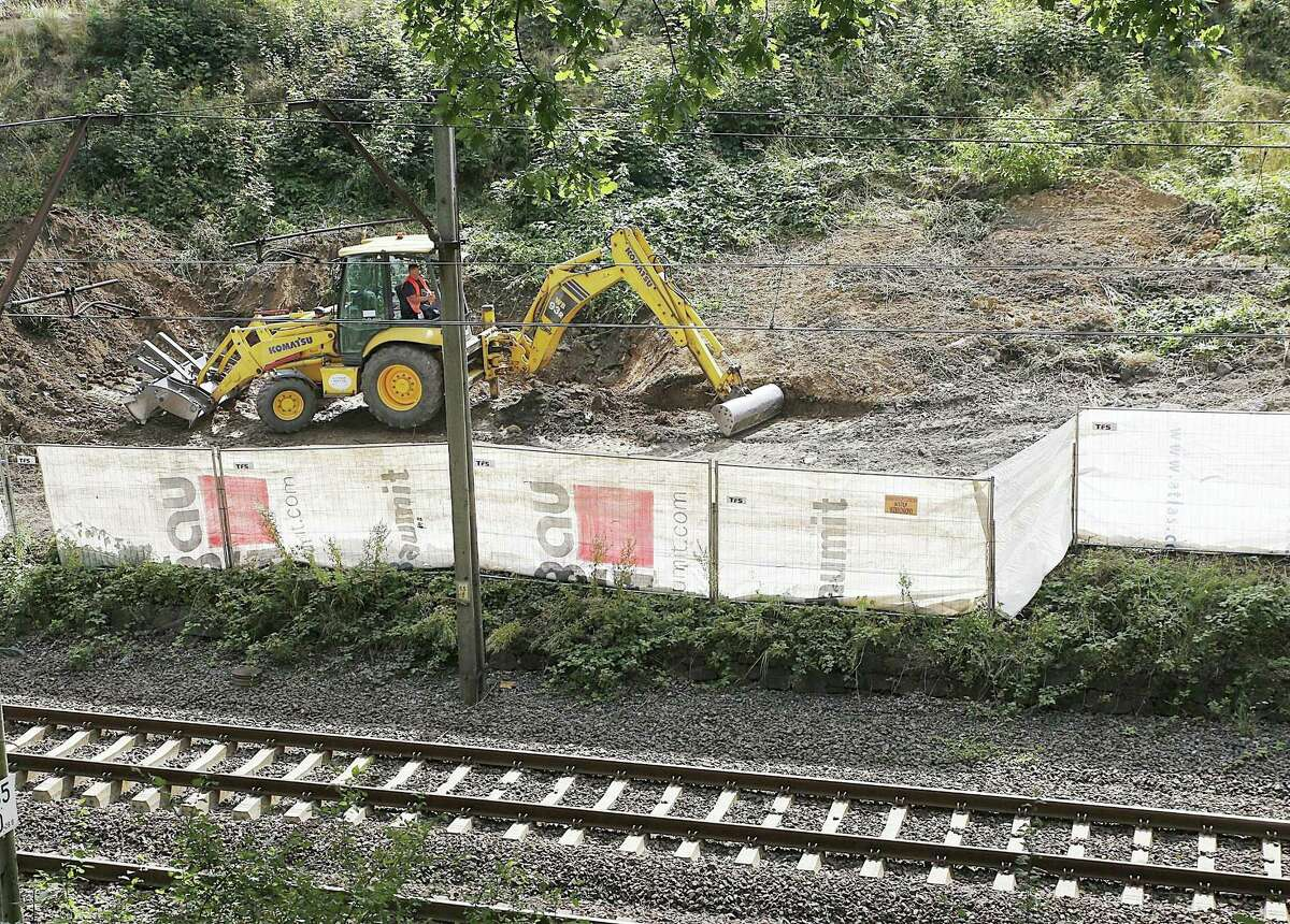 """In this Aug. 16, 2016, file picture heavy machinery begins the search, the work of explorers hoping to find a legendary Nazi train laden with treasure and armaments in Walbrzych, Poland. Explorers' great hopes for finding a legendary Nazi """"gold train"""" in Poland appeared dashed Wednesday Aug. 24, 2016, when, after digging extensively, they admitted they have found """"no train, no tunnel"""" at the site."""