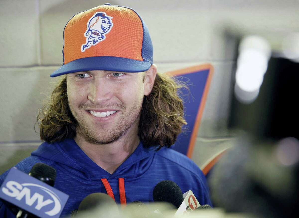 Mets pitcher Jacob deGrom talks to reporters at Citi Field in New York on Thursday.