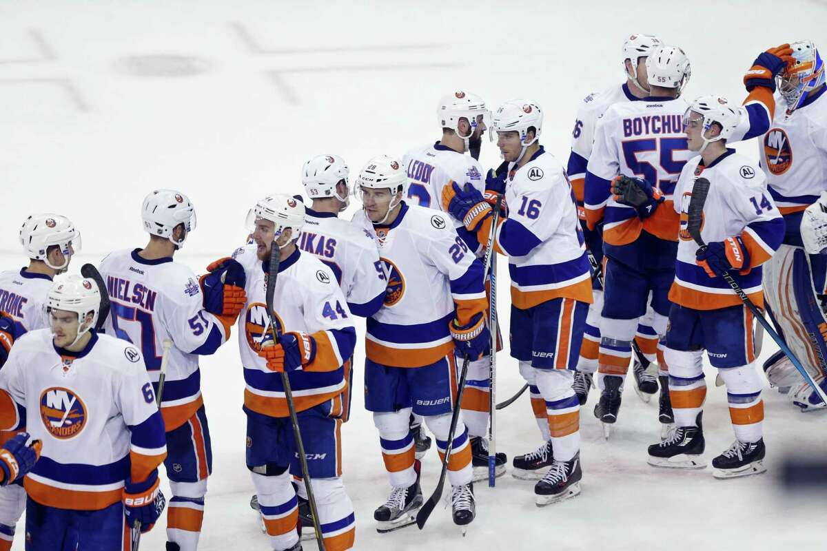 Members of the Islanders celebrate after their win over the rangers on Thursday.