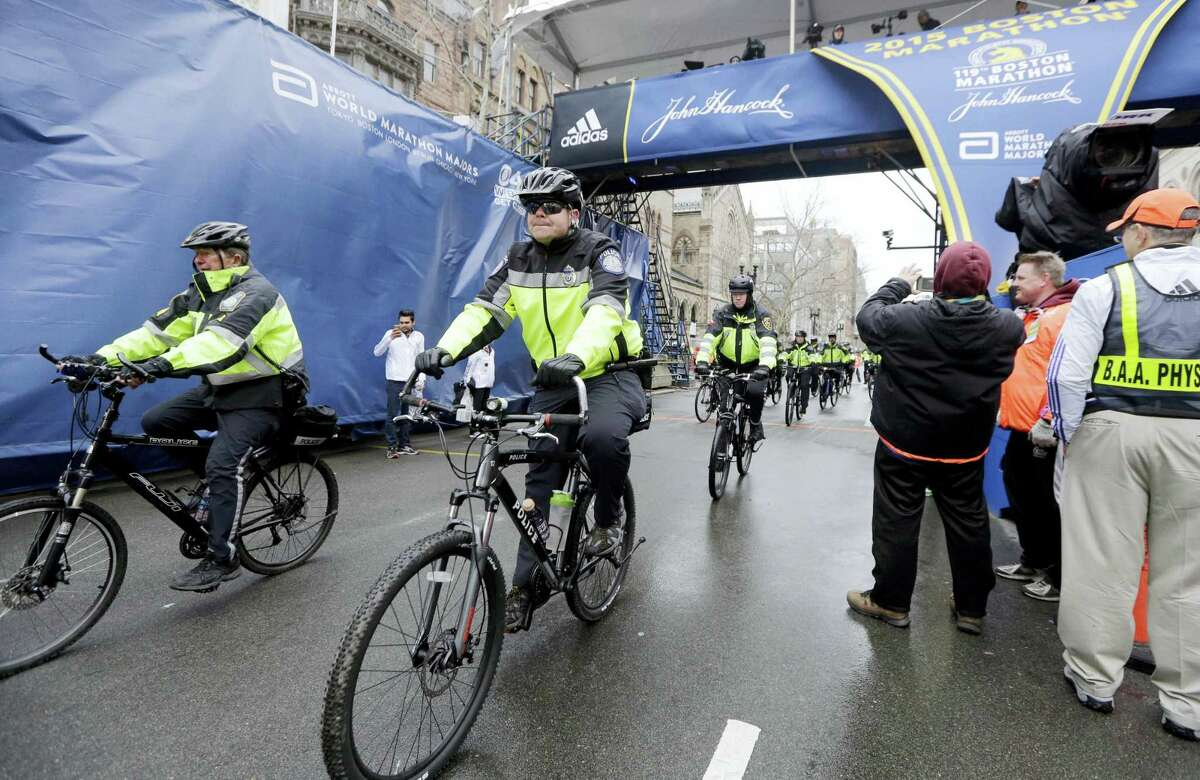 AP Photo/Elise Amendola, File In this April 20, 2015, file photo, police officers patrol near the finish line of the Boston Marathon in Boston. Multiple law enforcement agencies will provide security for the 120th Boston Marathon set to be run on Monday, April 18, 2016.