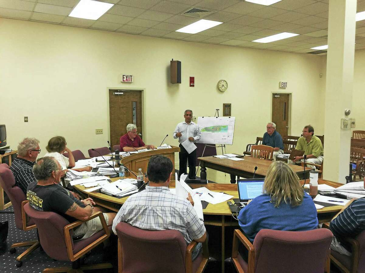 Ben Lambert - The Register CitizenRob Colabella of Lenard Engineering presents plans for a new Henny Penny gas station to the Winchester Planning and Zoning Commission Monday.