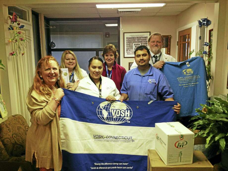 Front, from left, Torrington attorney Audrey Blondin, doctor's assistant Evelyn Cabrera and optometry assistant Orlando Sevilla; back, from left, office manager Nicole Gaynor, Harwington Lions Club member Nancy Schnyer and Dr. Matthew Blondin. They are preparing to travel to Nicaragua in January for the annual vision assistance mission, providing glasses and treatment to thousands of citizens in the coastal city of San Juan del Sur. A record 82 people are taking the trip this year. Photo: Emily M. Olson - The Register Citizen