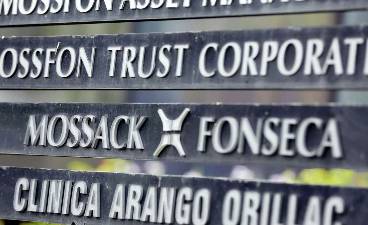 In this April 4, 2016 photo, a marquee on a building in Panama City, Panama, lists the Mossack Fonseca law firm, one of the leaders in setting up offshore bank accounts for the rich and powerful. Offshore accounts conjure up images of malicious misdeeds, but many people use them for more than just hiding bribes and laundering money. And offshore accounts can be a financial tool for more than just the ultra-wealthy, too.