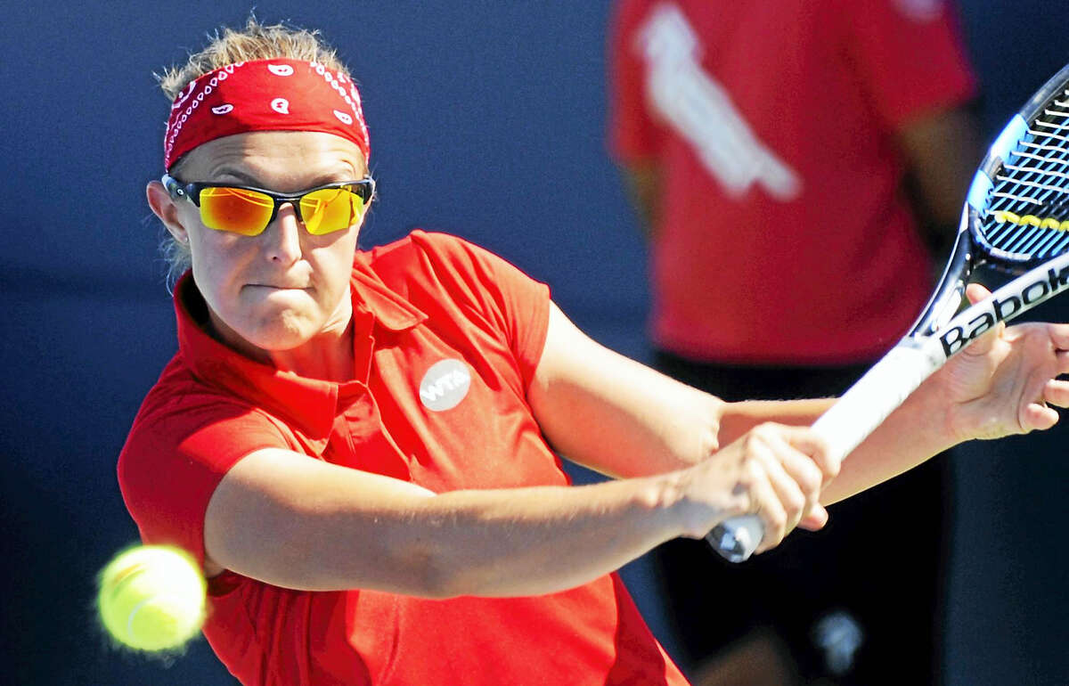 Kirsten Flipkens lines up a backhand return at the Connecticut Open Tuesday in New Haven. Flipkens defeated Belinda Bencic in three sets to advance to the second round.