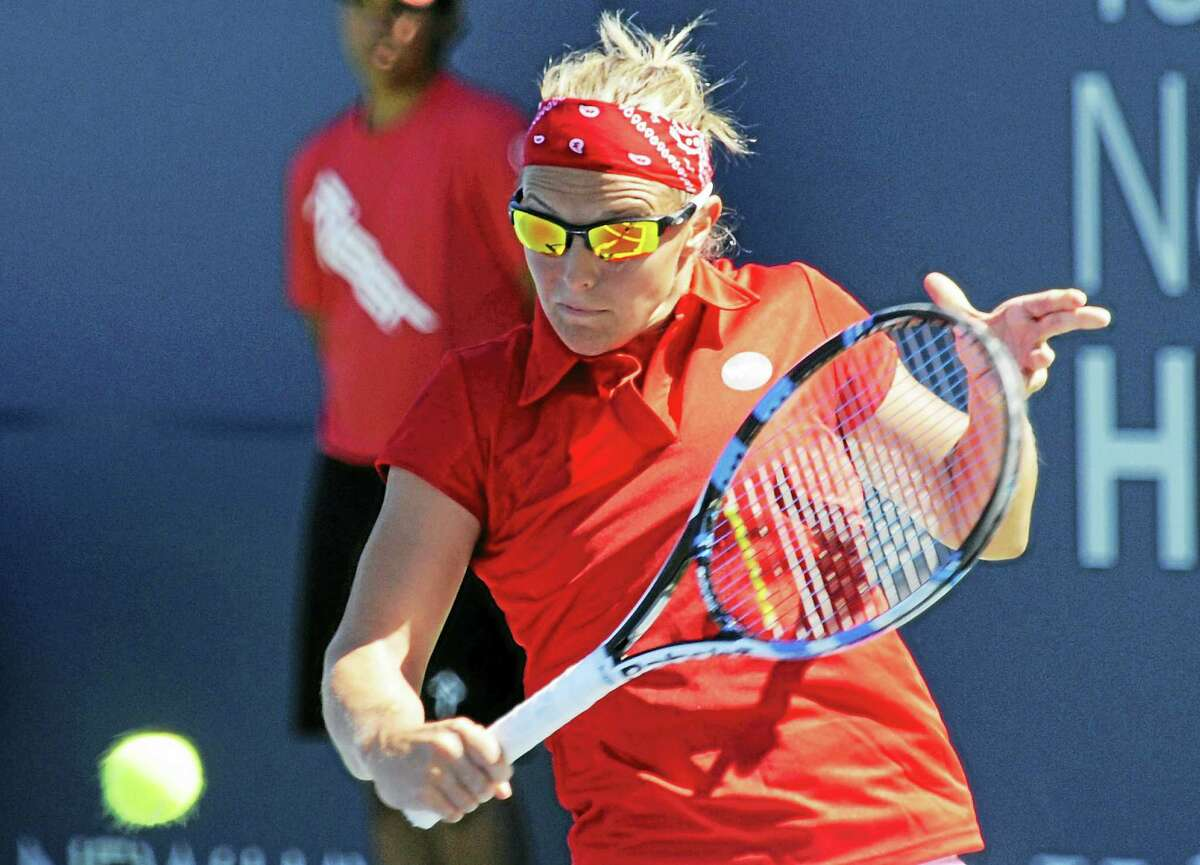 Kirsten Flipkens makes a volley during her three-set victory over Belinda Bencic at the Connecticut Open.