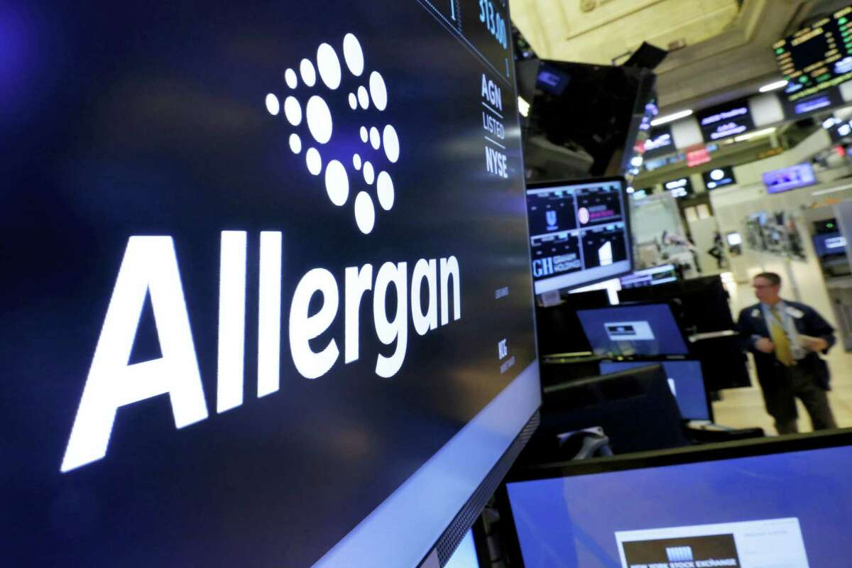 In this Nov. 23, 2015 photo, the Allergan logo appears above a trading post on the floor of the New York Stock Exchange.
