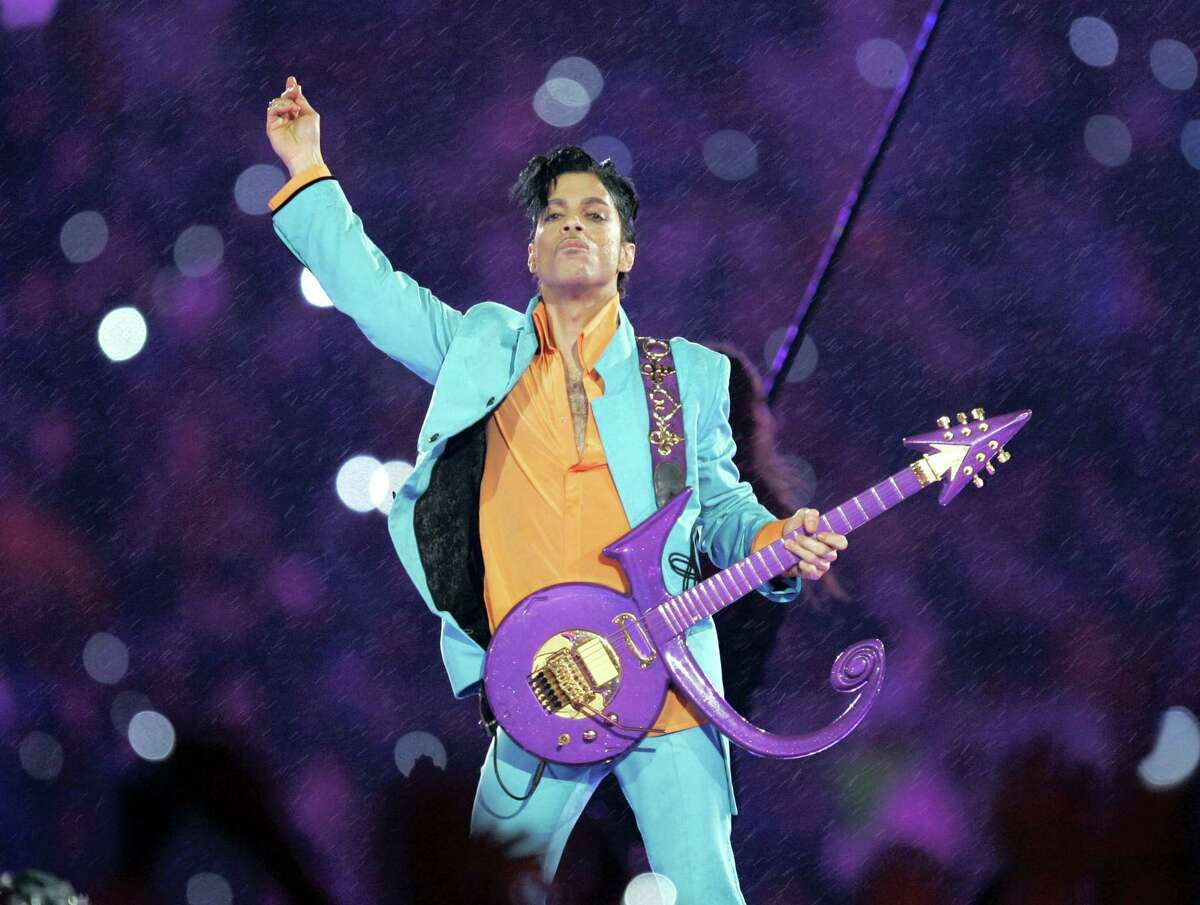 In this Feb. 4, 2007, file photo, Prince performs during the halftime show at the Super Bowl XLI football game at Dolphin Stadium in Miami. The disclosure that some pills found at Prince's Paisley Park home and studio were counterfeit and contained the powerful synthetic opioid fentanyl strongly suggests they came to the superstar illegally. Prince died April 21, 2016, of an accidental fentanyl overdose.