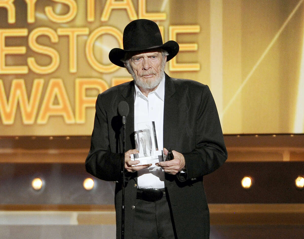 In this April 6, 2014 file photo, Merle Haggard accepts the crystal milestone award at the 49th annual Academy of Country Music Awards in Las Vegas.Haggard died of pneumonia, Wednesday, April 6, 2016, in Palo Cedro, Calif. He was 79.