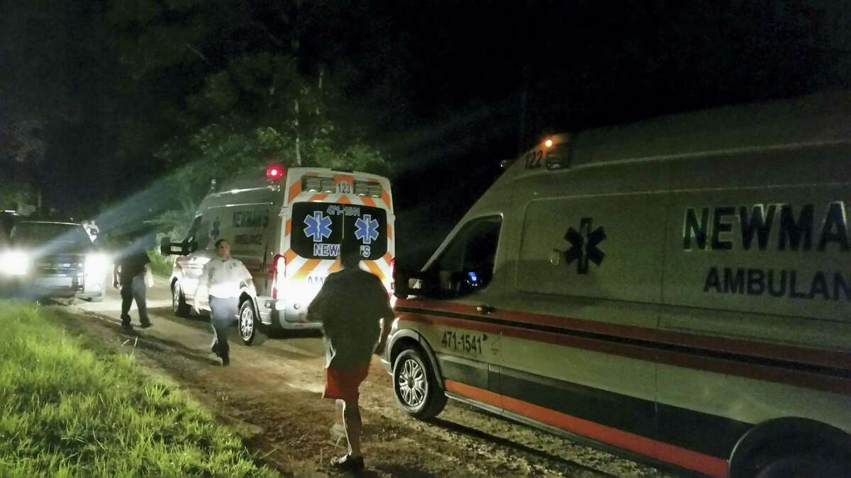 Ambulances wait along Jim Platt Road west of Citronelle, Ala., joining a stream of law enforcement vehicles at the scene of multiple homicides on Saturday, Aug. 20, 2016. The suspect in the killing of multiple people at a home in Alabama attacked them while they slept and then abducted his estranged girlfriend and an infant, both of whom were found alive, authorities said Sunday.