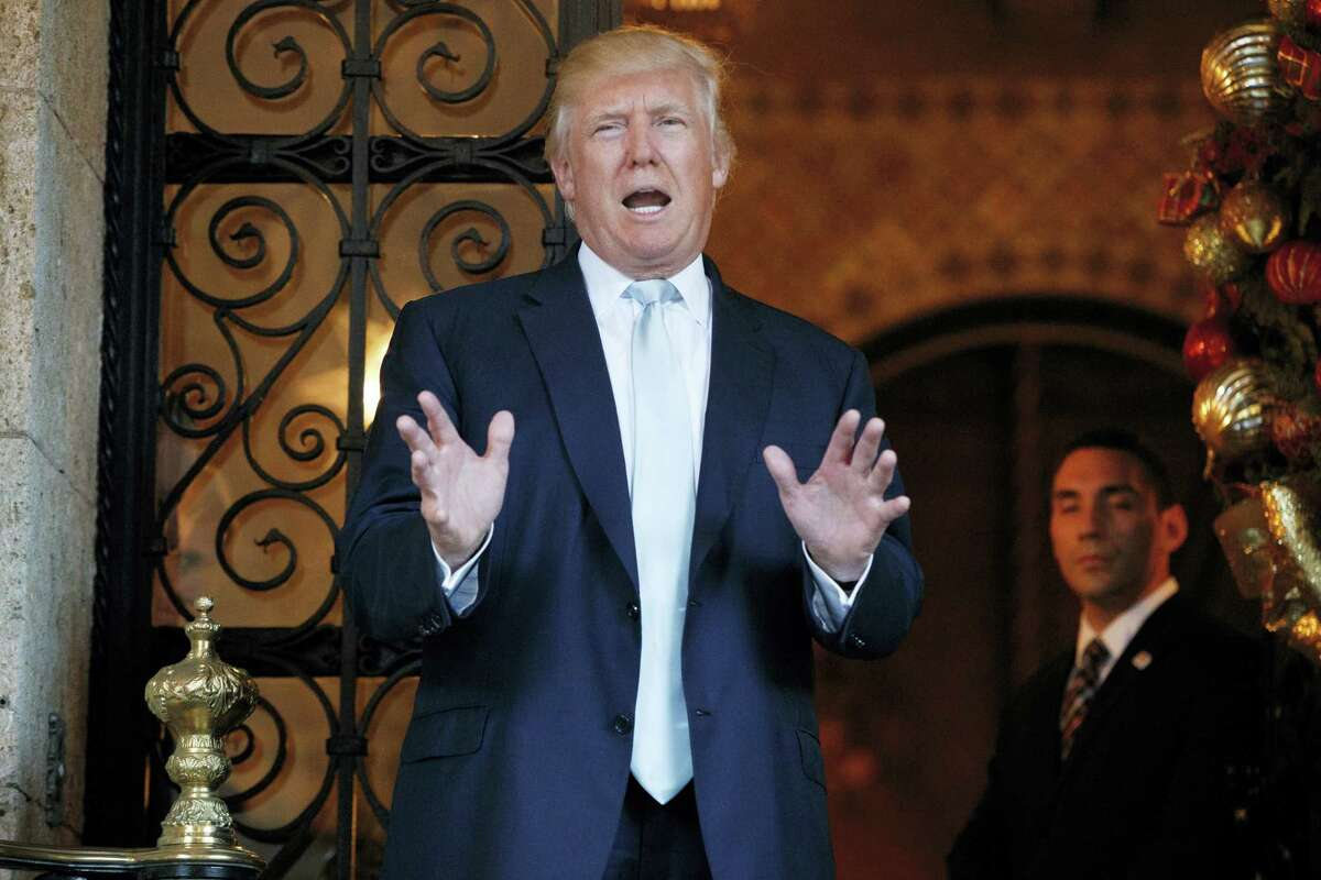 President-elect Donald Trump speaks to reporters at Mar-a-Lago, Wednesday, Dec. 28, 2016, in Palm Beach, Fla.