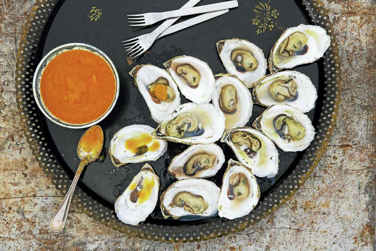 """Grilled oysters with habenero sauce from """"Fresh Fish"""" by Jennifer Trainer Thompson."""