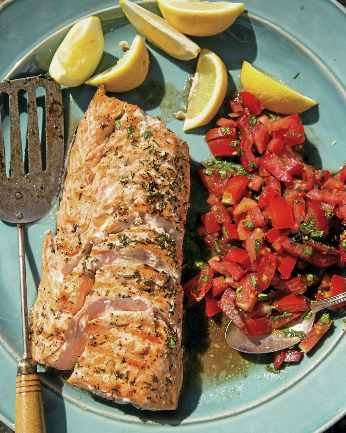 """Grilled salmon with tomato-basil relish from """"Fresh Fish"""" by Jennifer Trainer Thompson."""