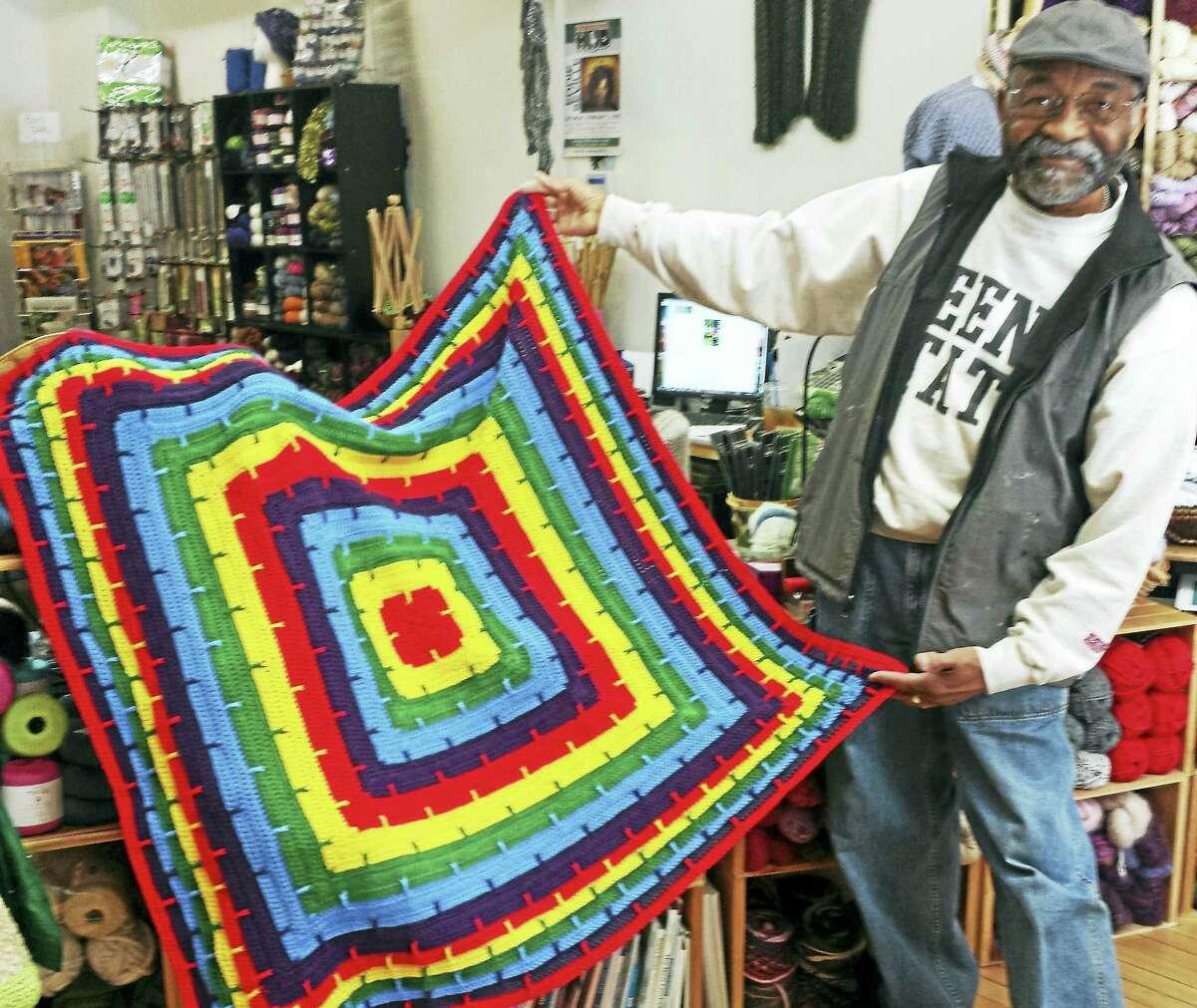 Photo by Ginger BalchJoe Harris, an avid crocheter, shows his latest creation.