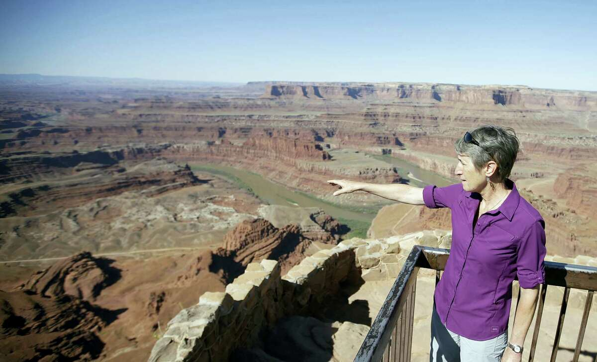 """FILE - This July 14, 2016, file photo, U.S. Interior Secretary Sally Jewell looks from Dead Horse Point, near Moab, Utah, during a tour to meet with proponents and opponents to the """"Bears Ears"""" monument proposal. President Barack Obama designated two national monuments Wednesday, Dec. 28, at sites in Utah and Nevada that have become key flashpoints over use of public land in the U.S. West."""