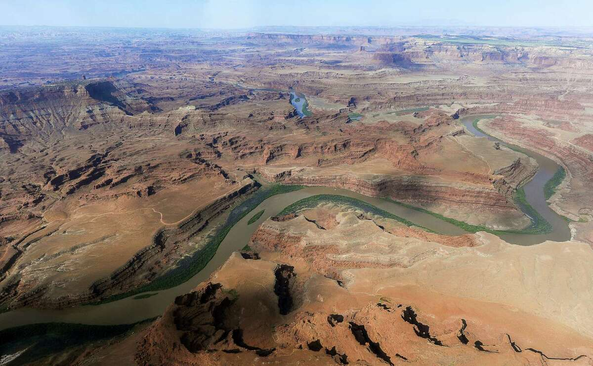 FILE - This May 23, 2016, file photo, shows the northernmost boundary of the proposed Bears Ears region, along the Colorado River, in southeastern Utah. President Barack Obama designated two national monuments Wednesday, Dec. 28, at sites in Utah and Nevada that have become key flashpoints over use of public land in the U.S. West. (Francisco Kjolseth/The Salt Lake Tribune via AP, File)