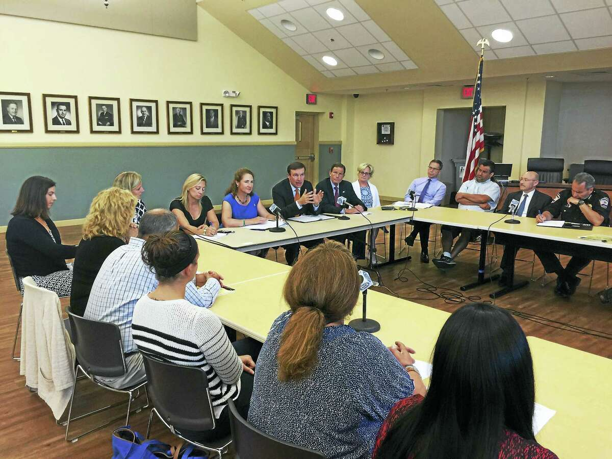 Ben Lambert - The Register Citizen Connecticut elected officials held a roundtable discussion with those involved with opioid addiction and treatment in Torrington Tuesday. Seated at the center table, from the left, are state Rep. Michelle Cook, U.S. Rep. Elizabeth Esty, U.S. Sen. Chris Murphy, U.S. Sen. Richard Blumenthal, and Torrington Mayor Elinor Carbone.