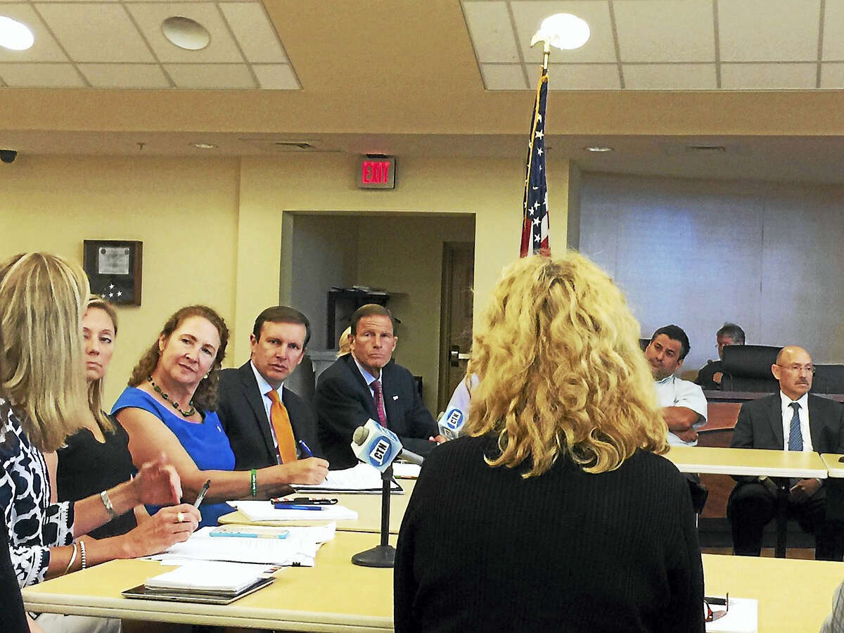 Ben Lambert - The Register Citizen From left, state Rep. Michelle Cook. U.S. Rep. Elizabeth Esty, U.S. Sen. Chris Murphy and U.S. Sen. Richard Blumenthal, listen to a speaker during a roundtable discussion on opiod addiction and treatment. The forum was held at Torrington City Hall on Tuesday afternoon. Local leaders, law enforcement representatives and others from the community were in attendance.
