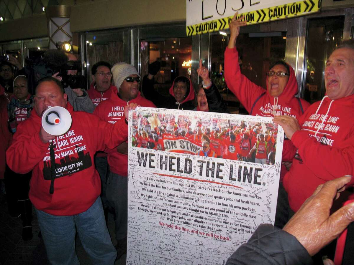 Striking union members protest outside the Trump Taj Mahal casino in Atlantic City, N.J., moments before it shut down. Whether owner Carl Icahn tries to reopen the building built in 1990 by incoming President Donald Trump is one of the big questions facing Atlantic City in 2017.