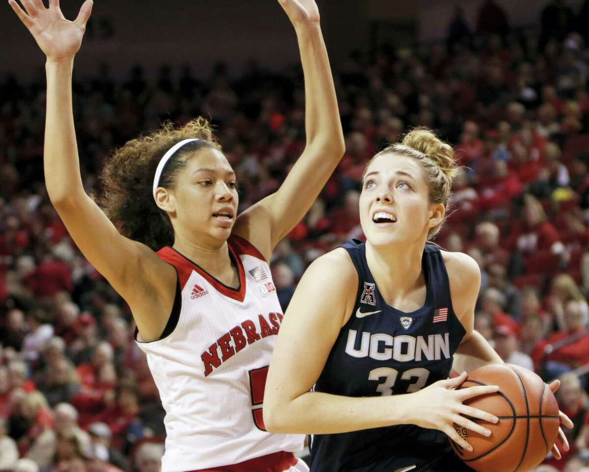 NATI HARNIK - THE ASSOCIATED PRESS UConn's Katie Lou Samuelson (33), right, looks for a way around Nebraska's Nicea Eliely (5) during the first half of UConn's win at Nebraska last week.