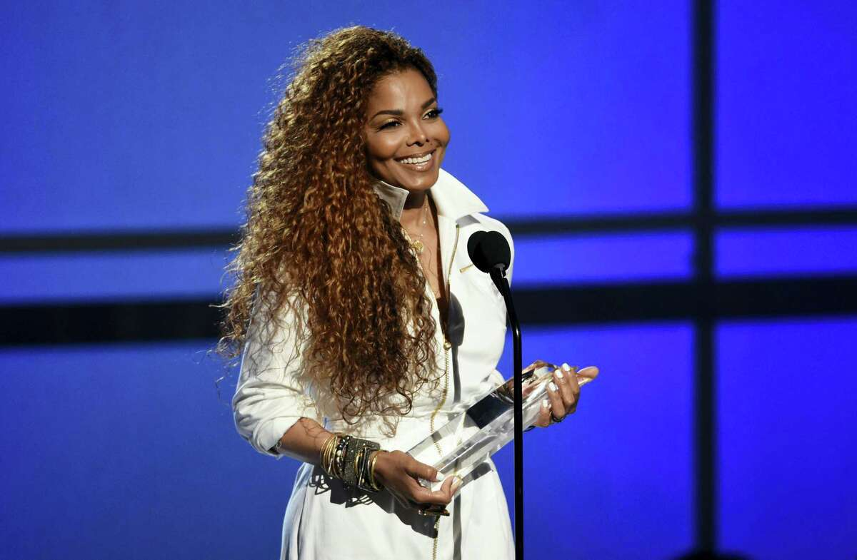 """In this June 28, 2015 photo, Janet Jackson accepts the ultimate icon: music dance visual award at the BET Awards at the Microsoft Theater in Los Angeles. Jackson is delaying her """"Unbreakable"""" tour, saying April 6, 2016 she and her husband are planning their family and that she is under doctor's orders to rest."""