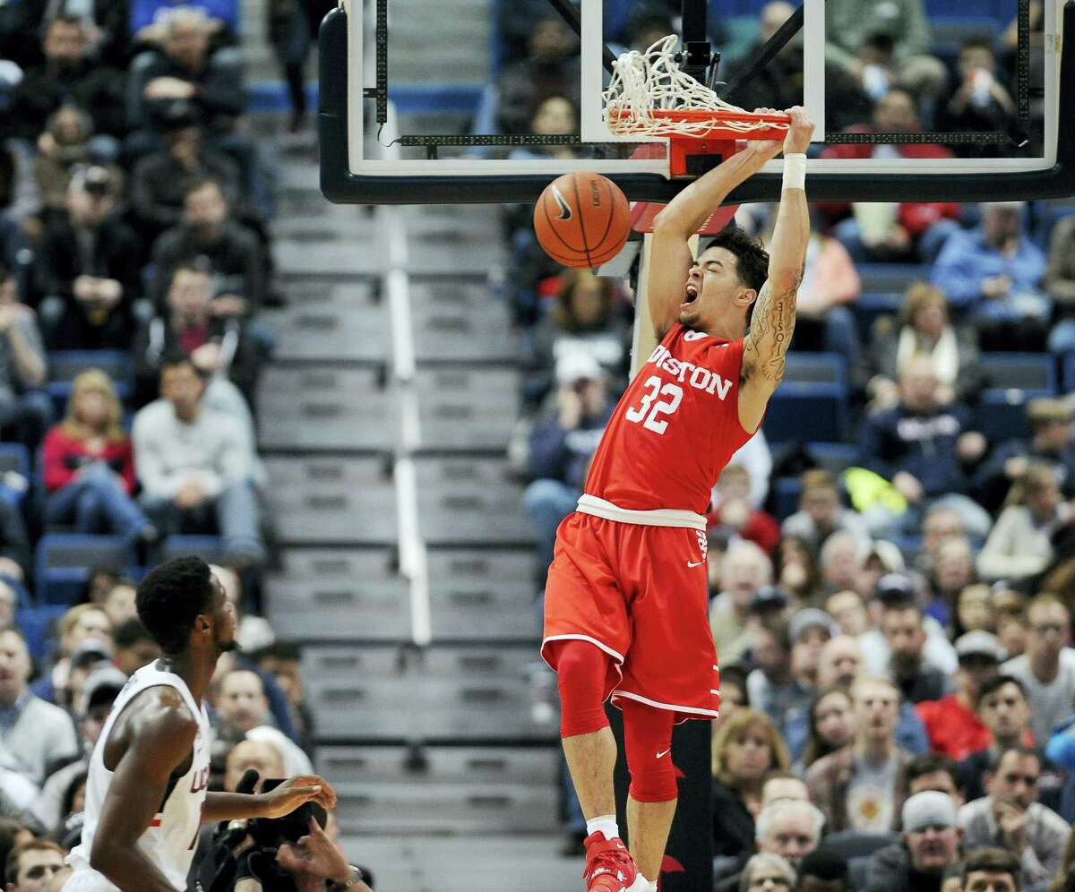 Houston's Rob Gray reacts while dunking the ball as UConn's Kentan Facey looks on, in the first half of the Huskies' loss to the Cougars.