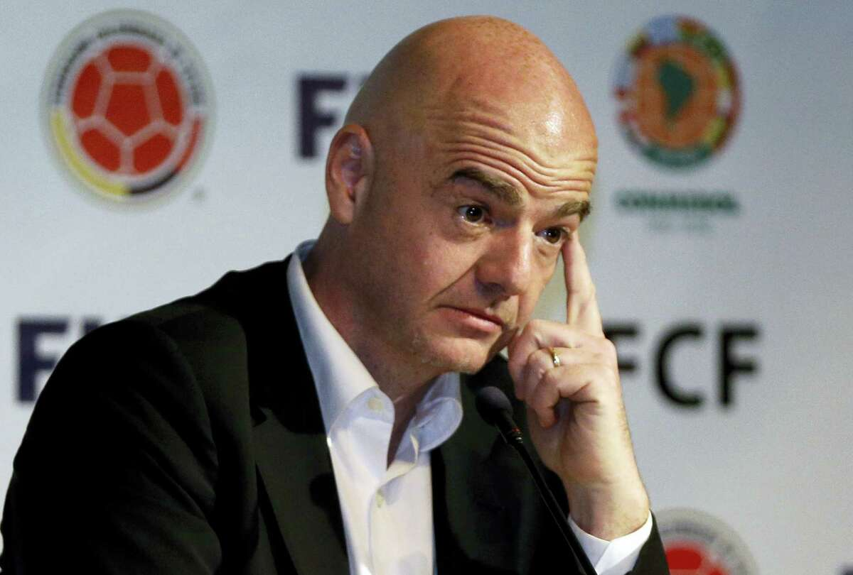 In this March 31, 2016 photo, FIFA President Gianni Infantino attends a press conference at the Soccer Federation headquarters in Bogota, Colombia. FIFA President Gianni Infantino has defended his reputation after a Champions League broadcasting contract he signed was leaked from a Panama-based law firm's database.