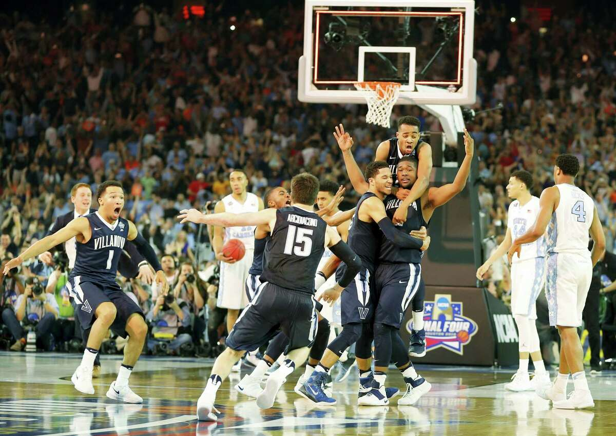 Villanova players celebrate after the NCAA Final Four tournament college basketball championship game against North Carolina, Monday, April 4, 2016, in Houston. Villanova won 77-74. (AP Photo/Kiichiro Sato)