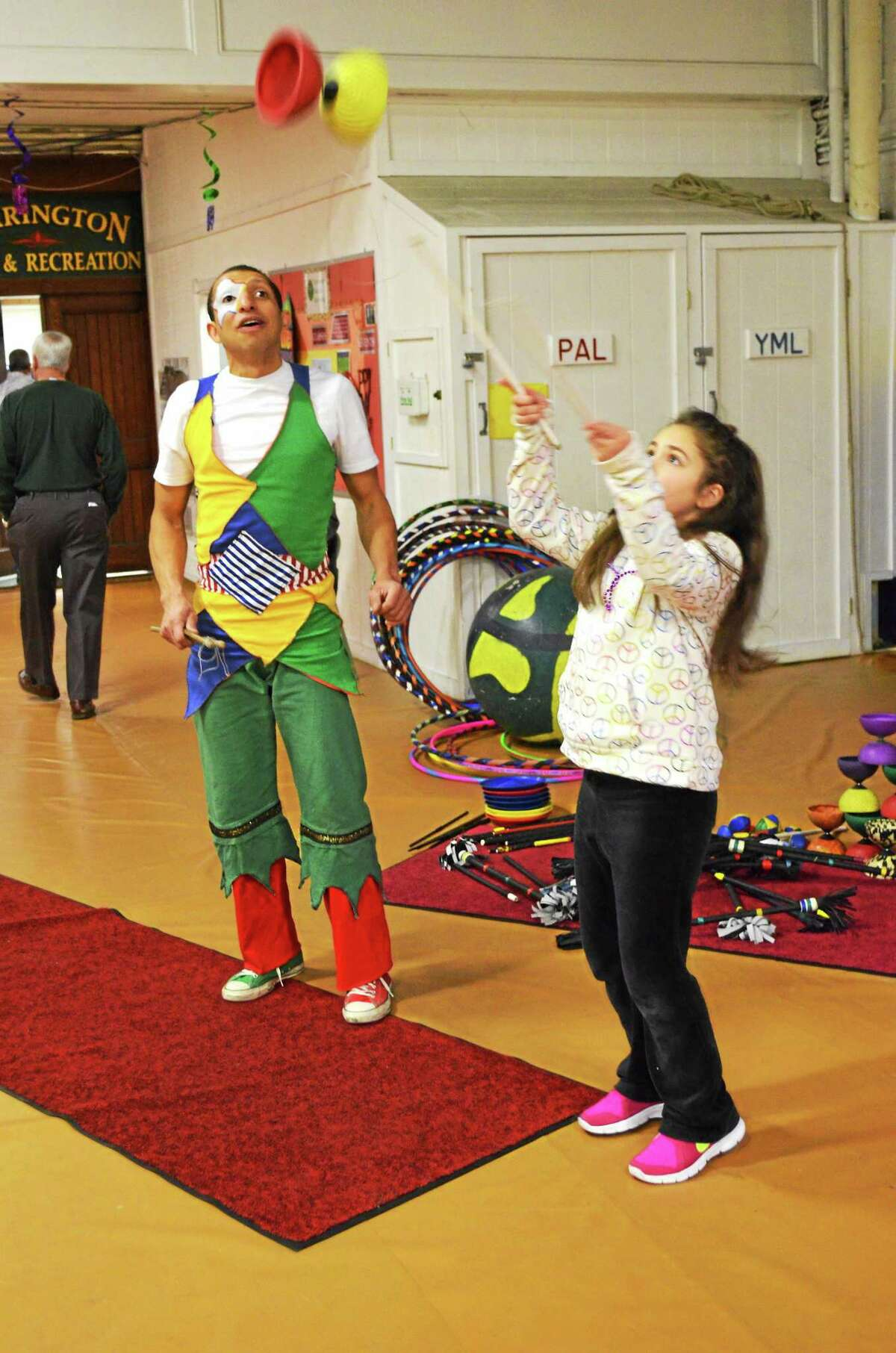 File photo - The Register Citizen Isabella Caruso, 8, of Torrington gets some lessons from Joel Melendez at the Torrington Armory for the city's Last Night celebration for New Year's Eve in 2014.