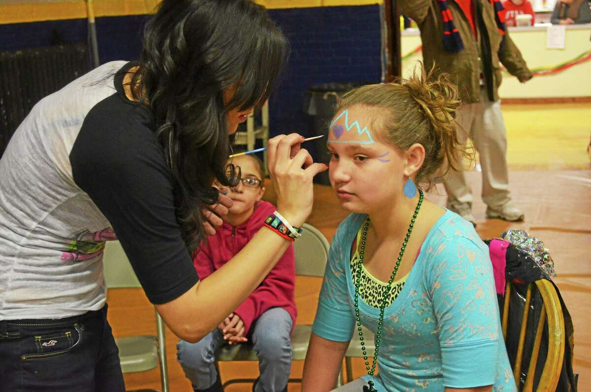 File photo - The Register Citizen Face painting is a popular activity for children at Last Night in Torrington.