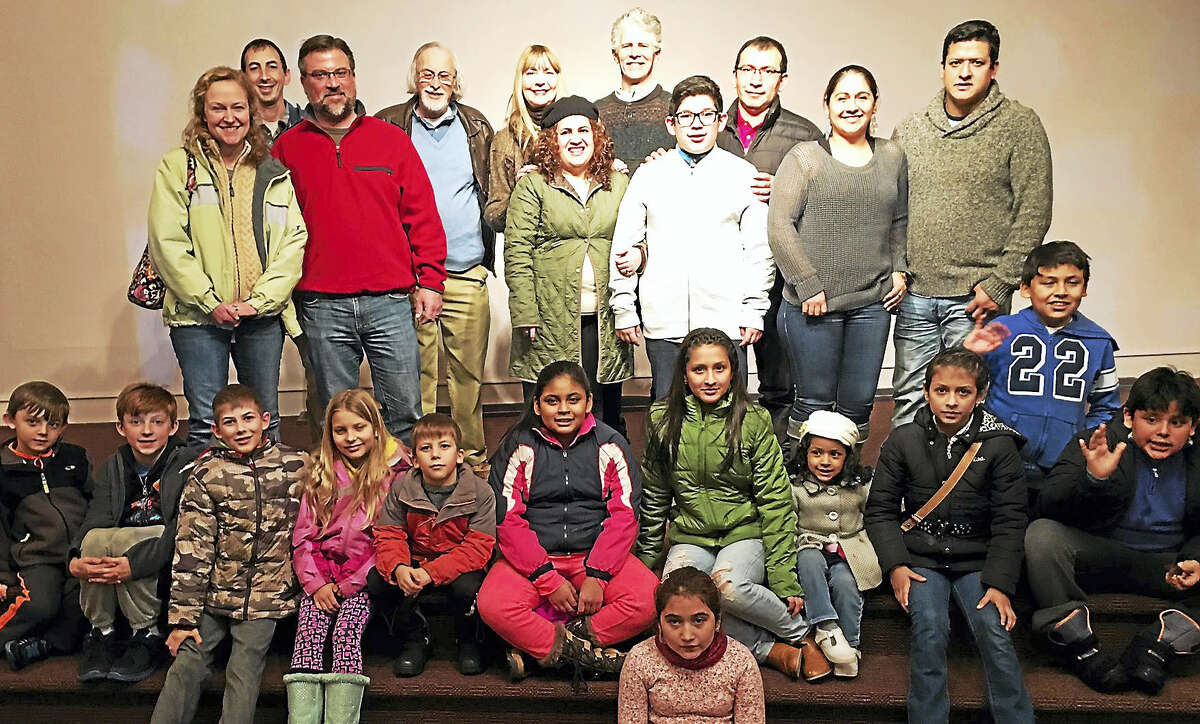 Contributed photo - CAFTA Teresa and John Sullivan, center, with CAFTA Board member Roger Newbury, join a group of students and parents for a celebration thanking the sponsors of an after school arts program at the Torrington-based organization.